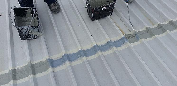 roof sheet overlaps cut edge coating inside masking taped area