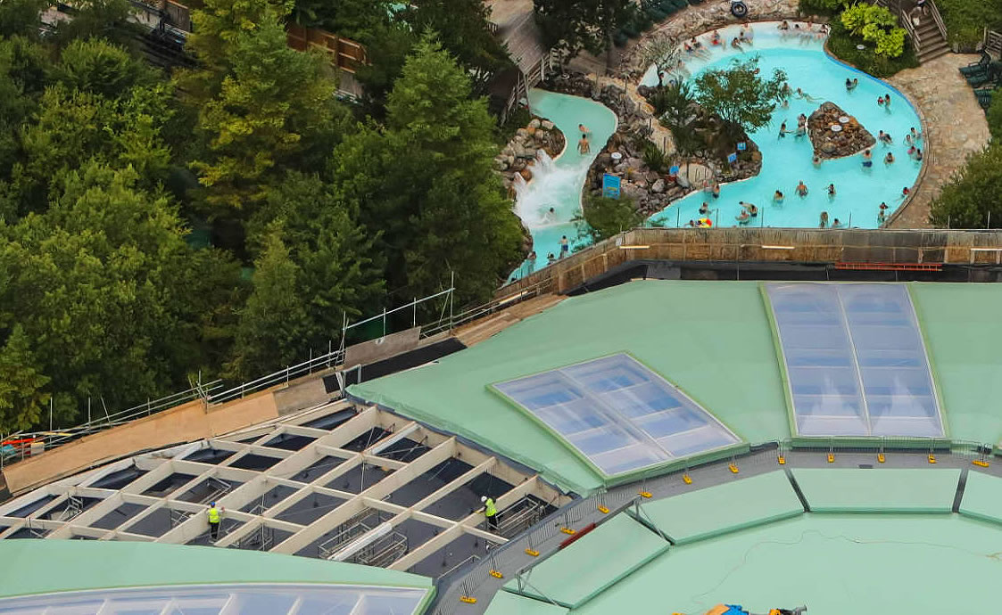 workers refurbish roof dome centre parcs longleat outdoor pool